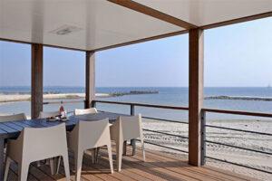 Huisje aan zee - Villa Comfort op Oasis Punt Beach Hotel and Beach Resort in Ouddorp